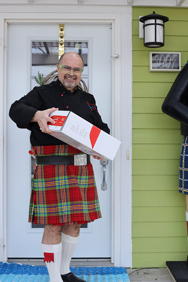 Kilted Chef Alain holding Foodie Box